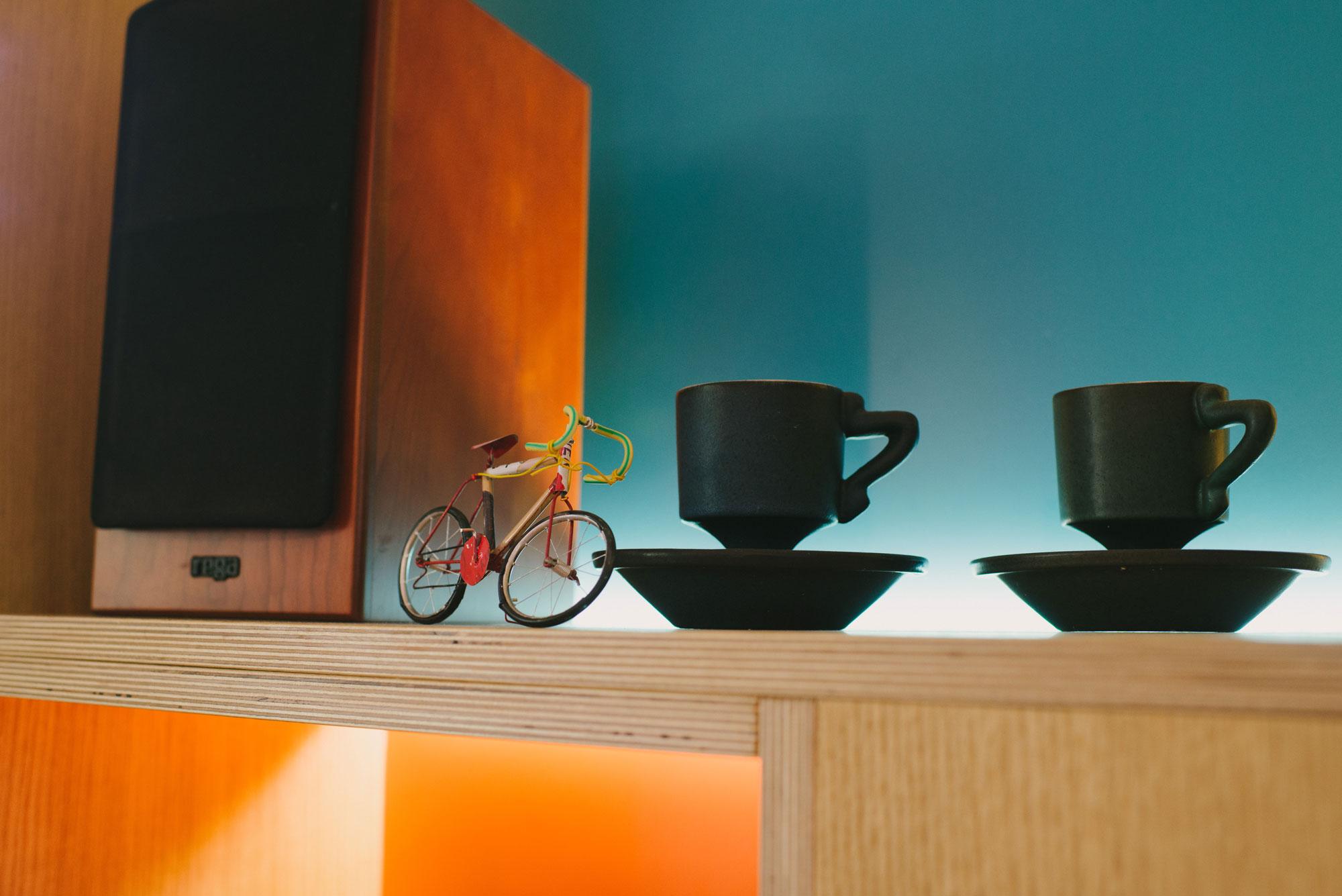 blue and orange plywood kitchen - shelving