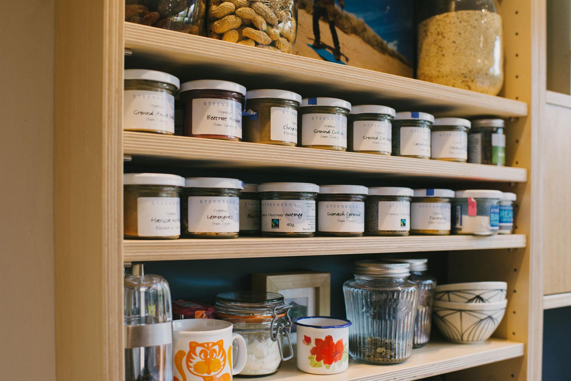 Spice Jars on plywood shelf