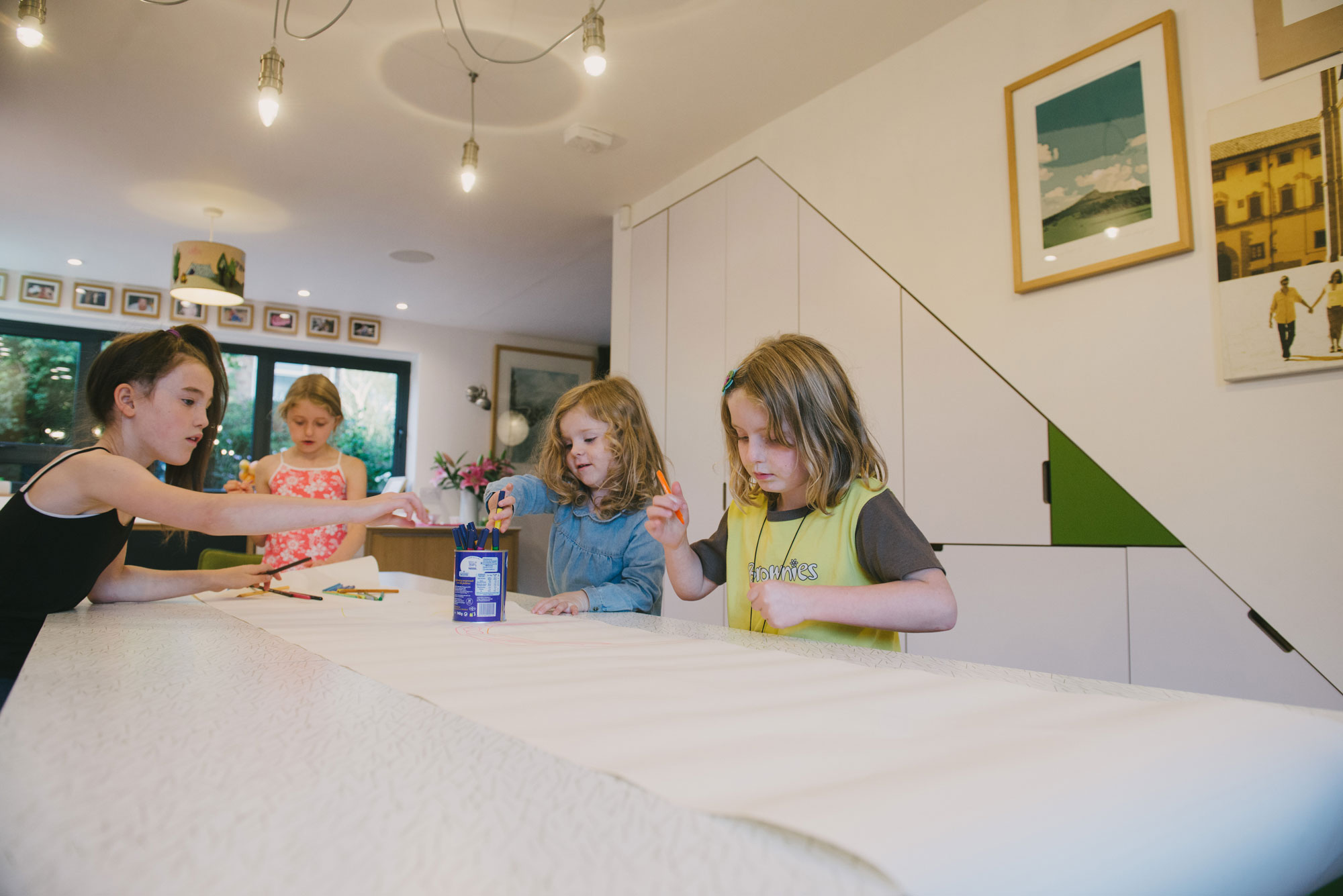 Children colouring in at the kitchen table