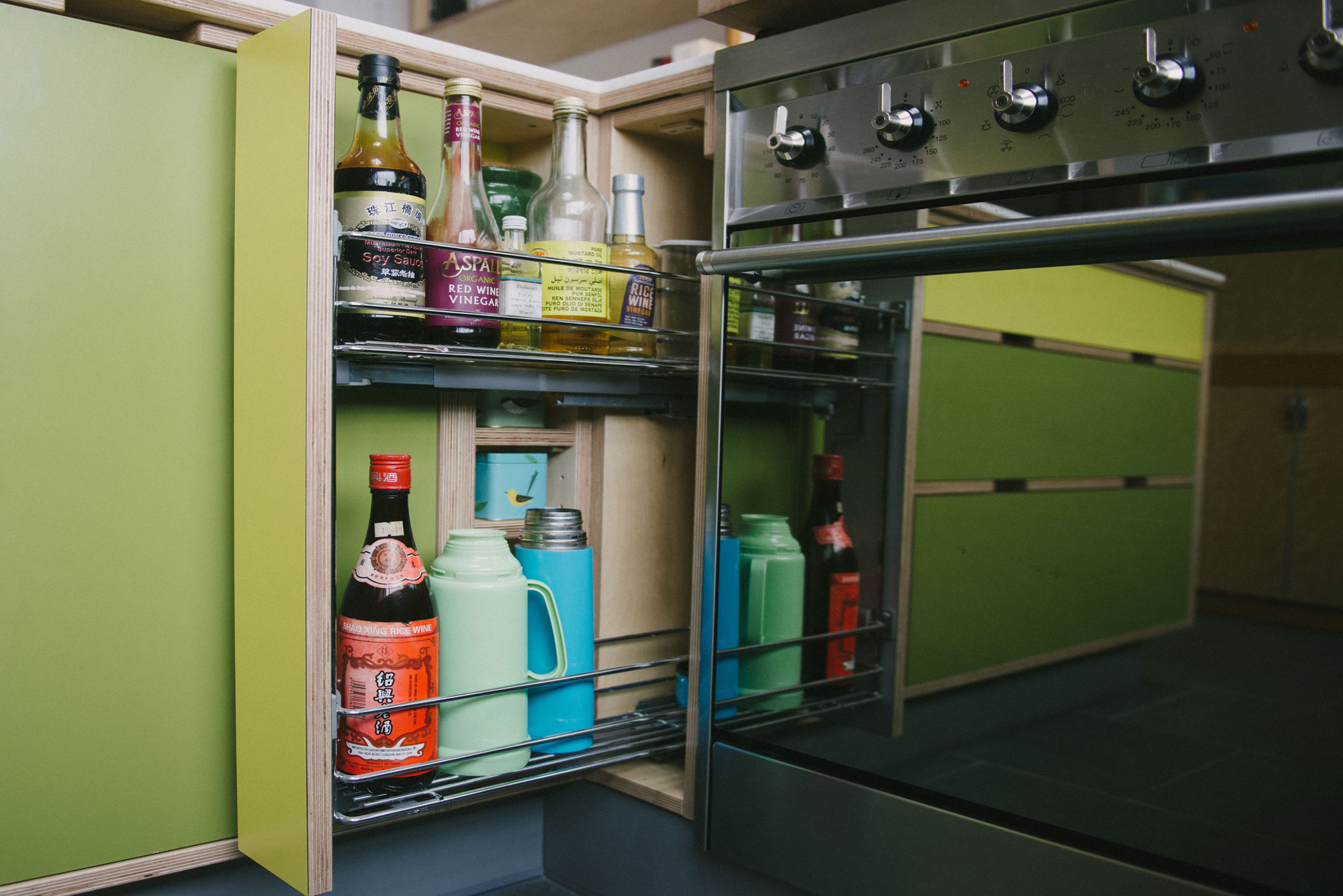 Green & yellow plywood kitchen pull out larder