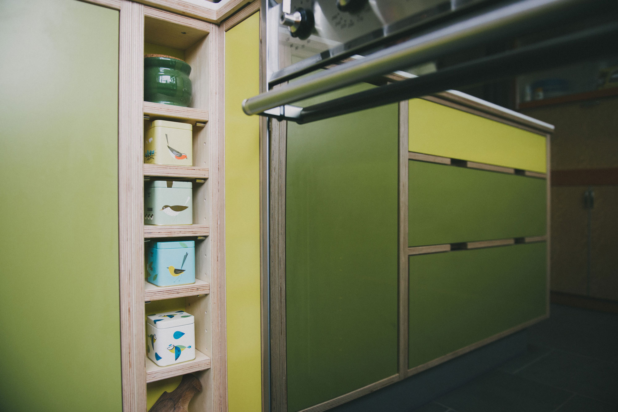 Green and yellow plywood kitchen - spice rack