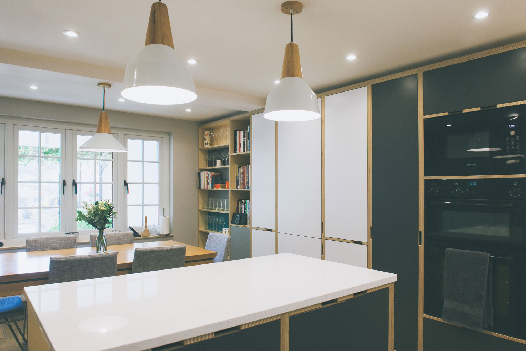 Open plan plywood kitchen diner