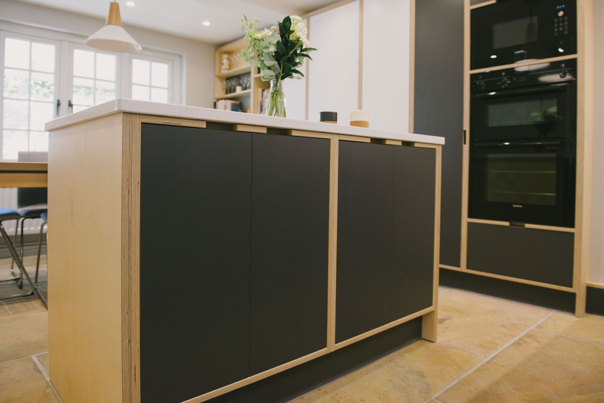 Corian surfaced plywood kitchen island unit