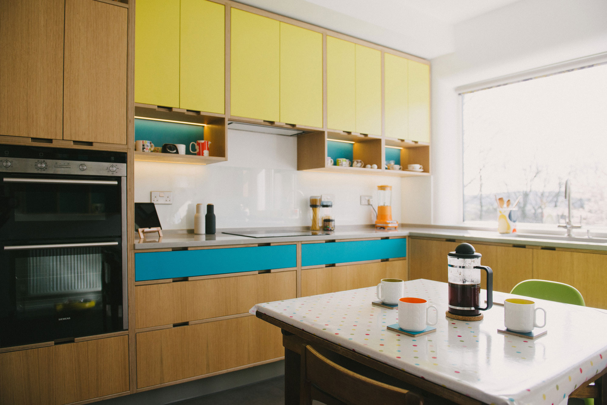 Retro yellow and blue plywood kitchen