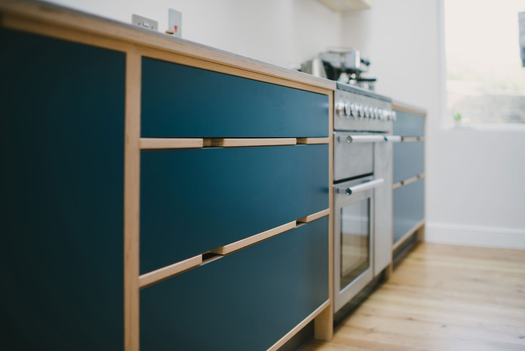 Drawer unit detail of plywood kitchen with Walnut kitchen island