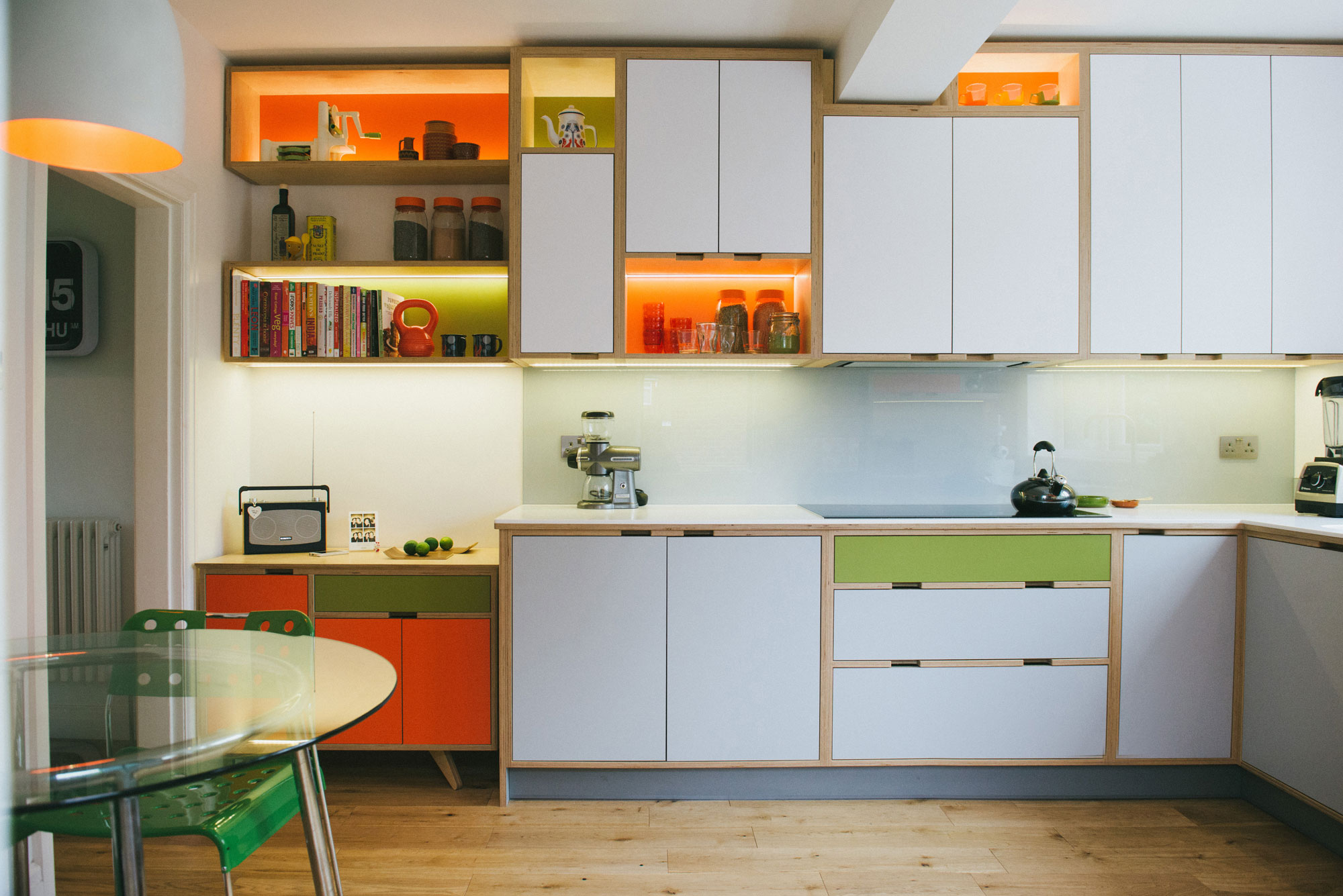 Orange and green plywood kitchen