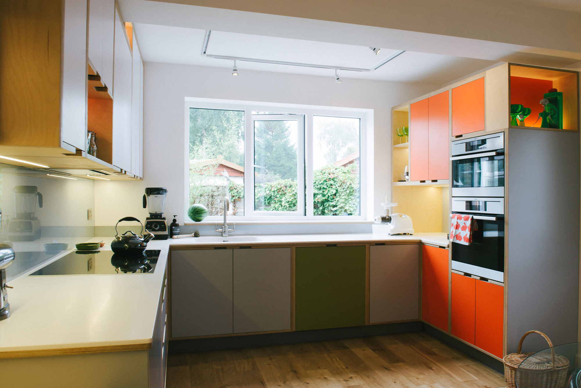 Orange and green kitchen