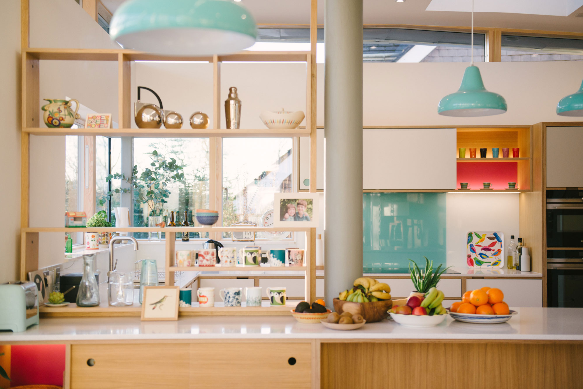 Open Shelving Defines Space Between Kitchen and Living Area