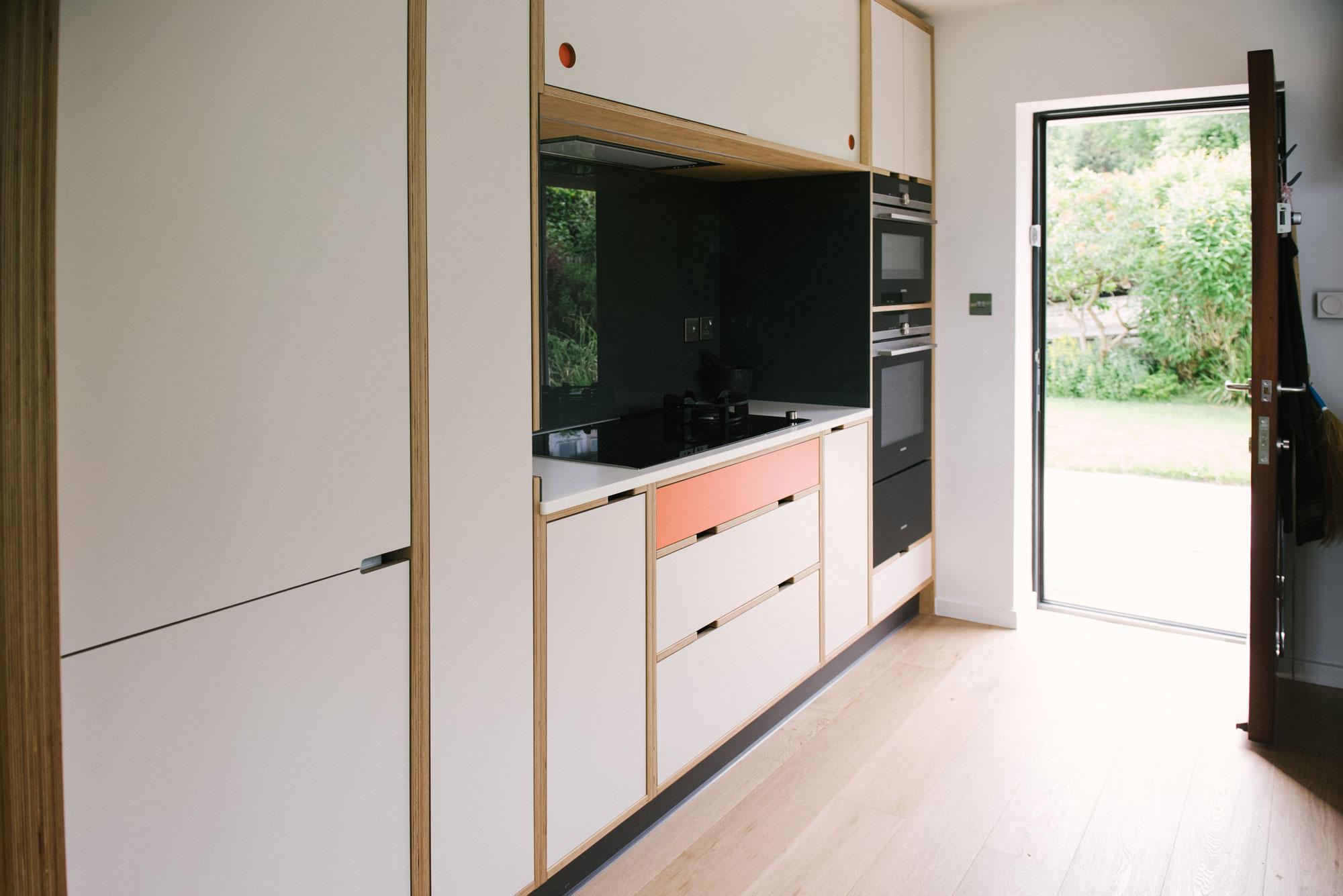 Mid Century Style Plywood Kitchen - White and Orange Kitchen