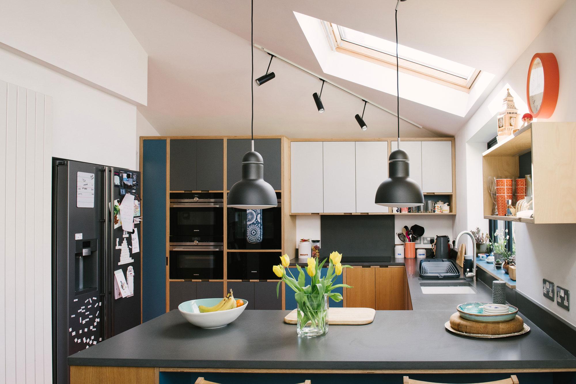 Fridge area of Plywood Kitchen With Orange Floor