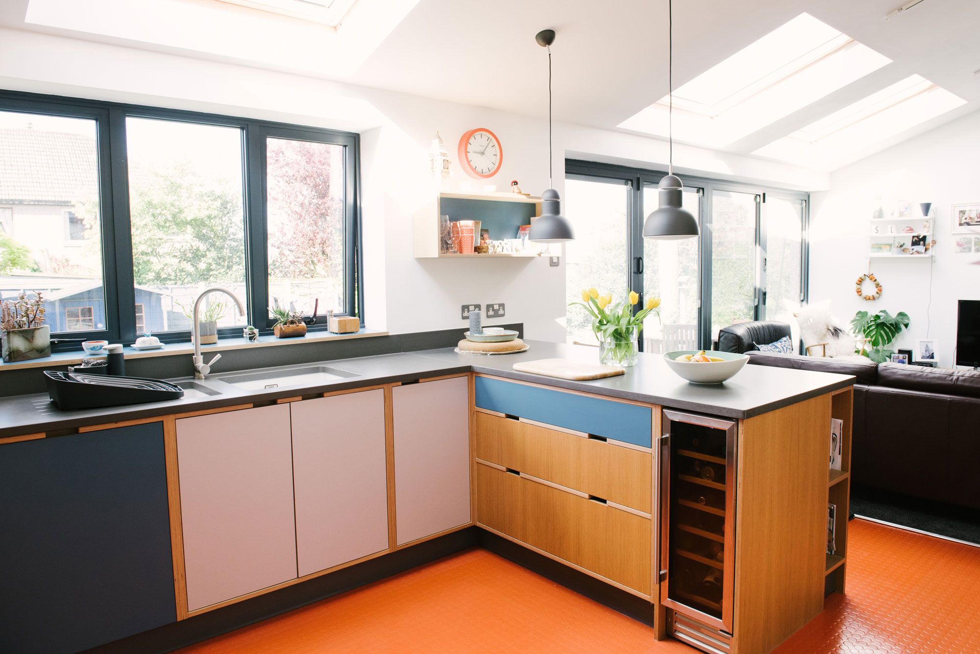Plywood Kitchen With Orange Floor Showing Wine Fridge
