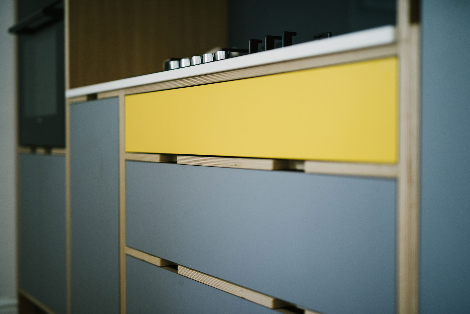 Grey and Yellow Plywood Kitchen Drawers
