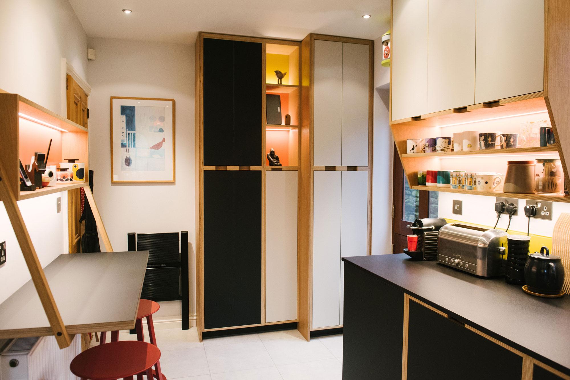 Breakfast Bar of Black Plywood Kitchen with Yellow Splashback