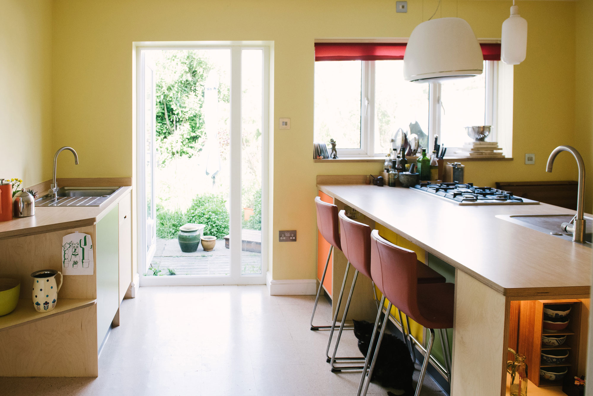 Orange and Yellow Plywood Kitchen