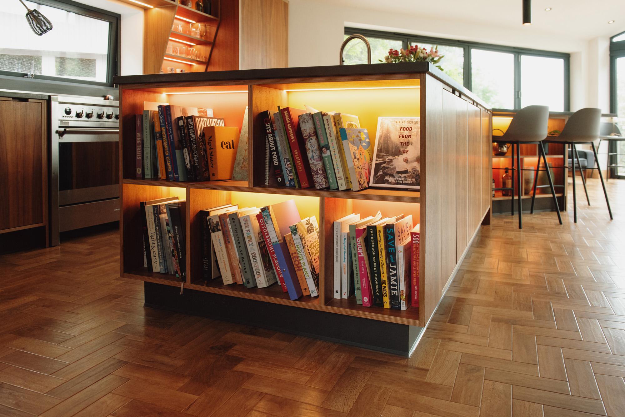 large island unit with illuminated bookshelf