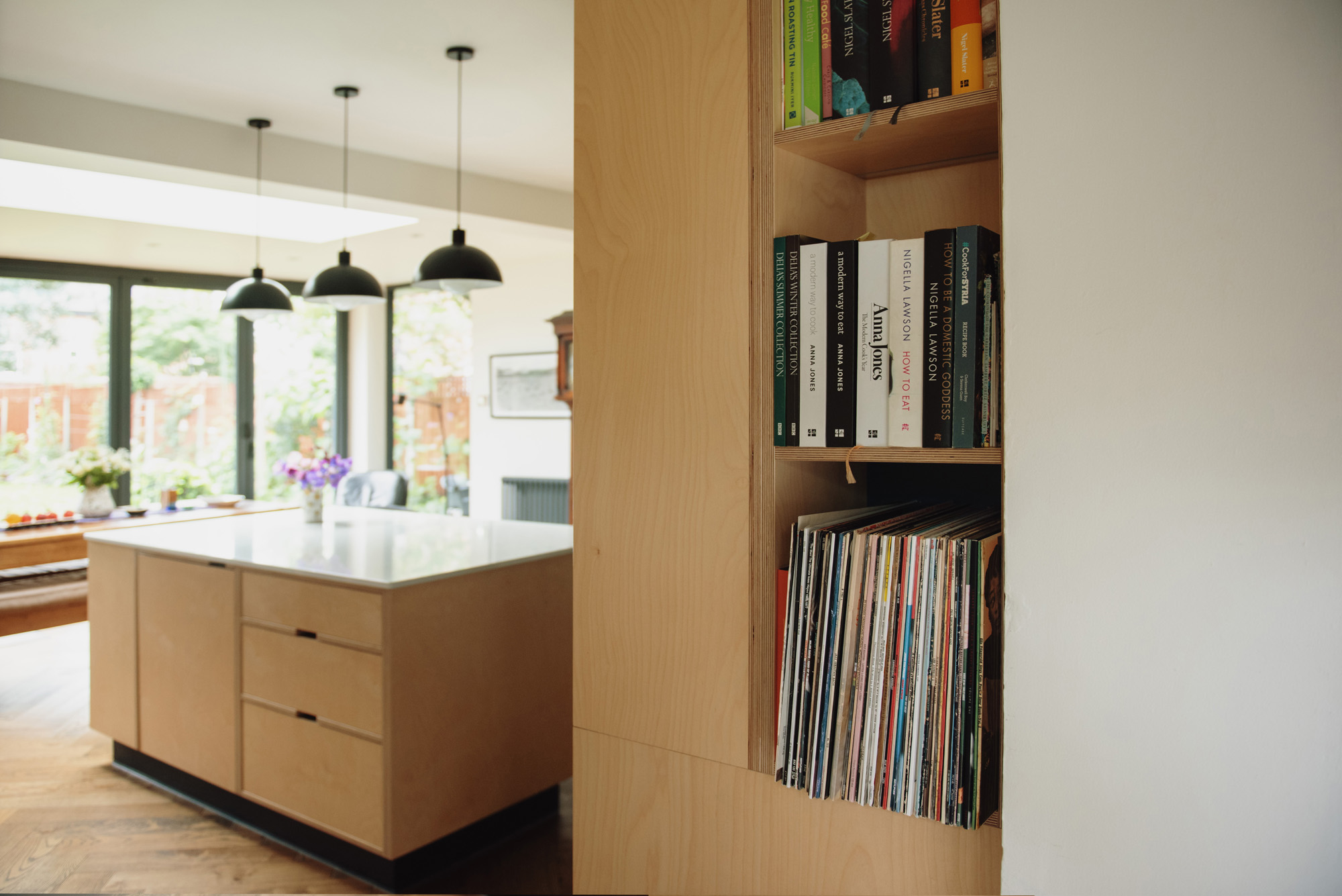 open plywood shelving between kitchen and utility