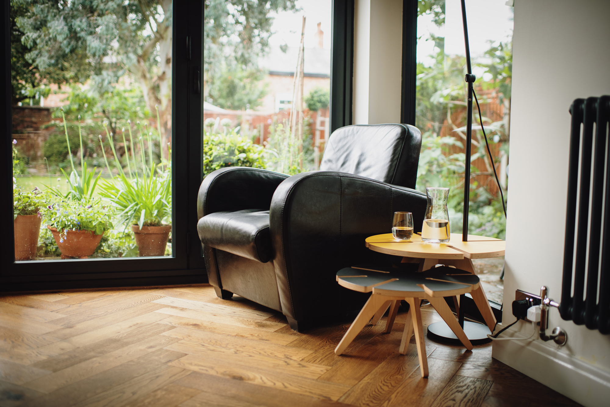 Leather Chair with plywood table in front of window