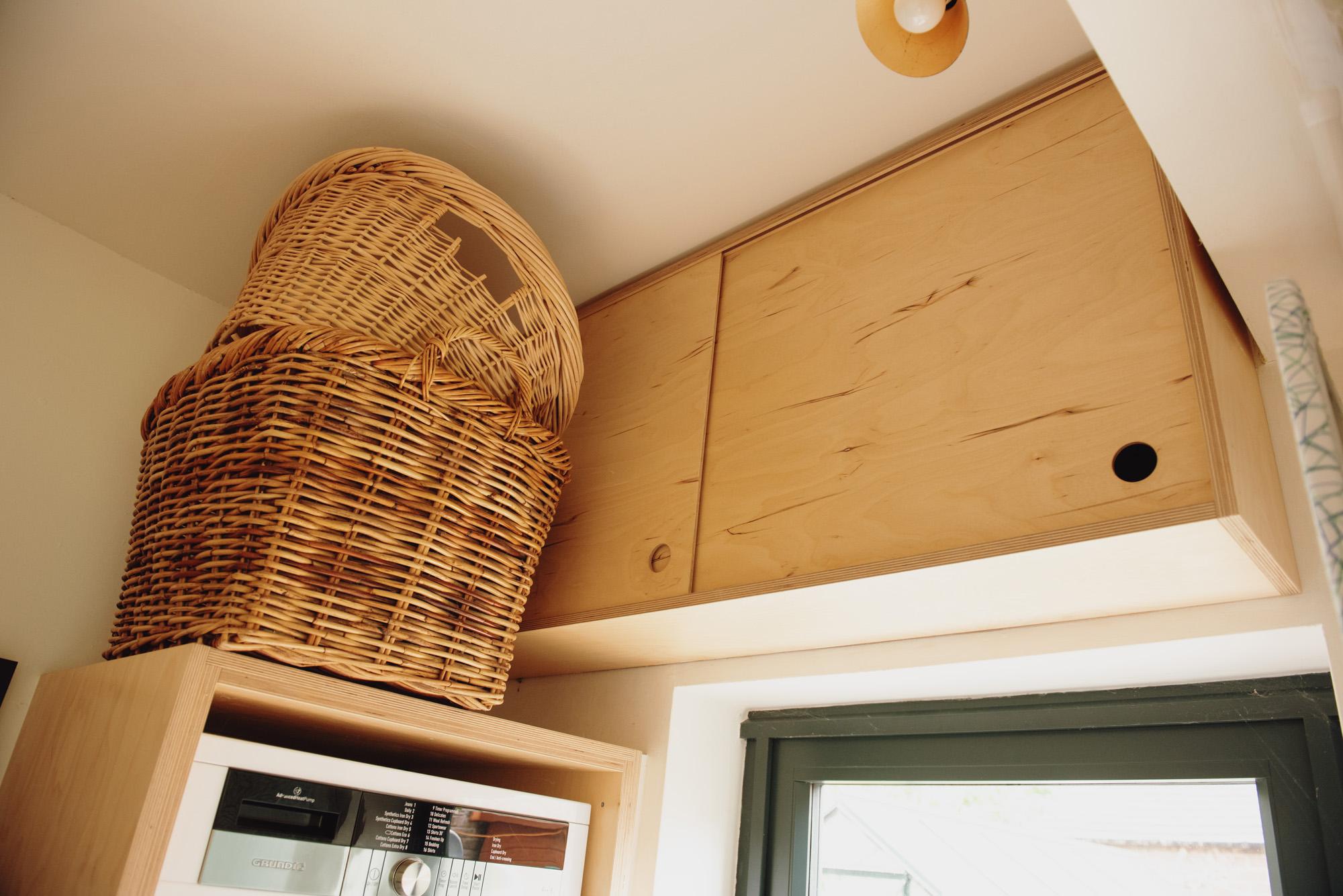 birch ply sliding cupboards over door