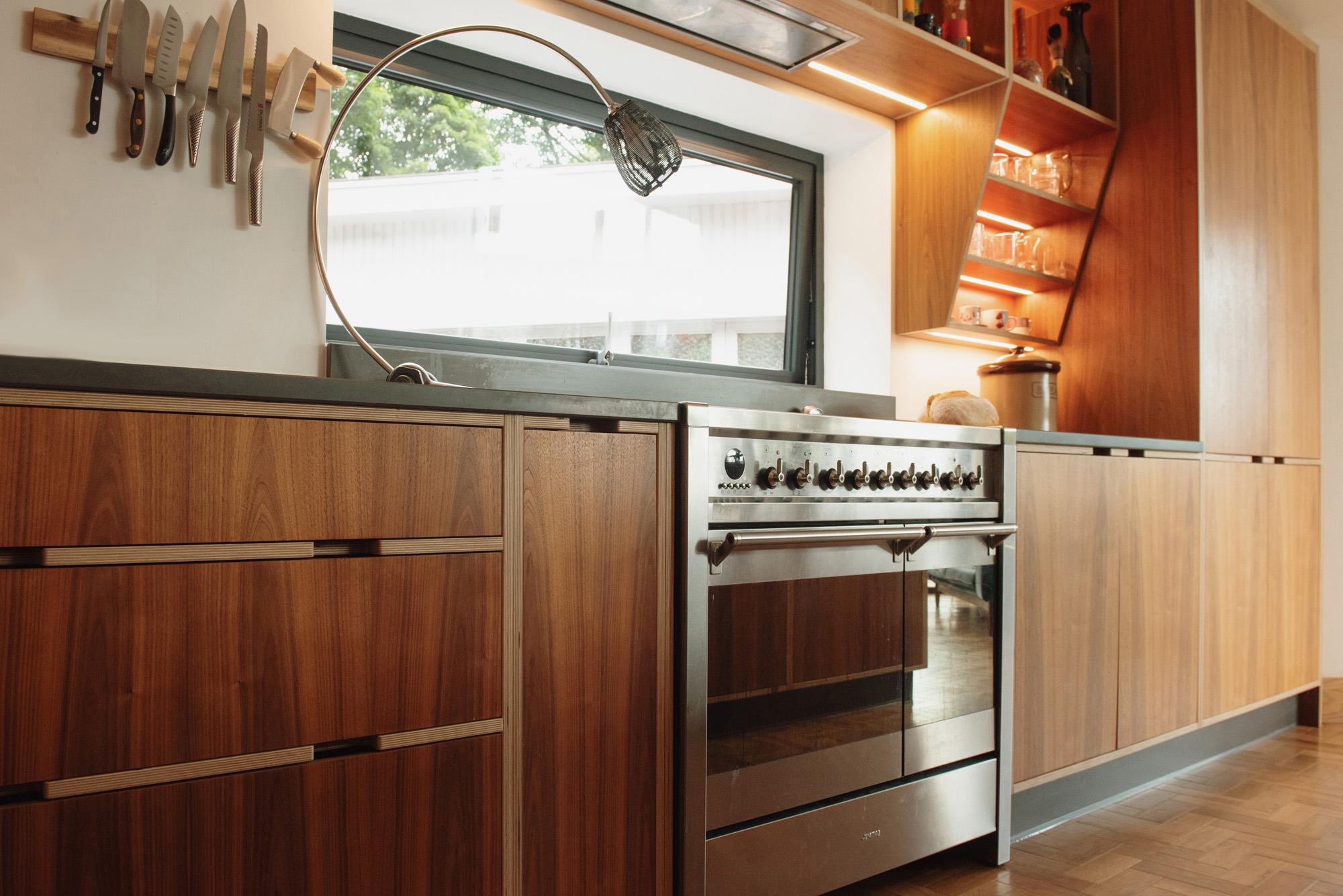 walnut kitchen with stainless steel range cooker