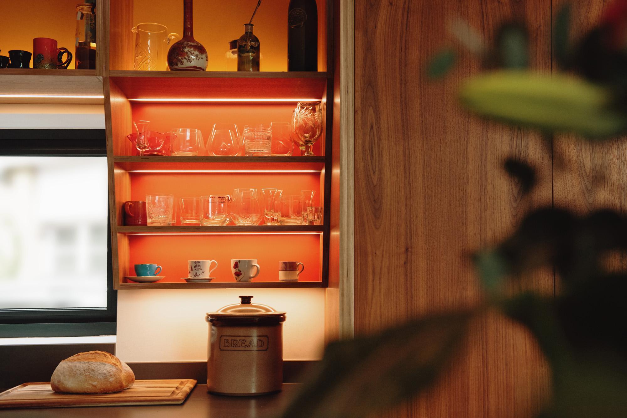 illuminated kitchen shelving displaying glassware